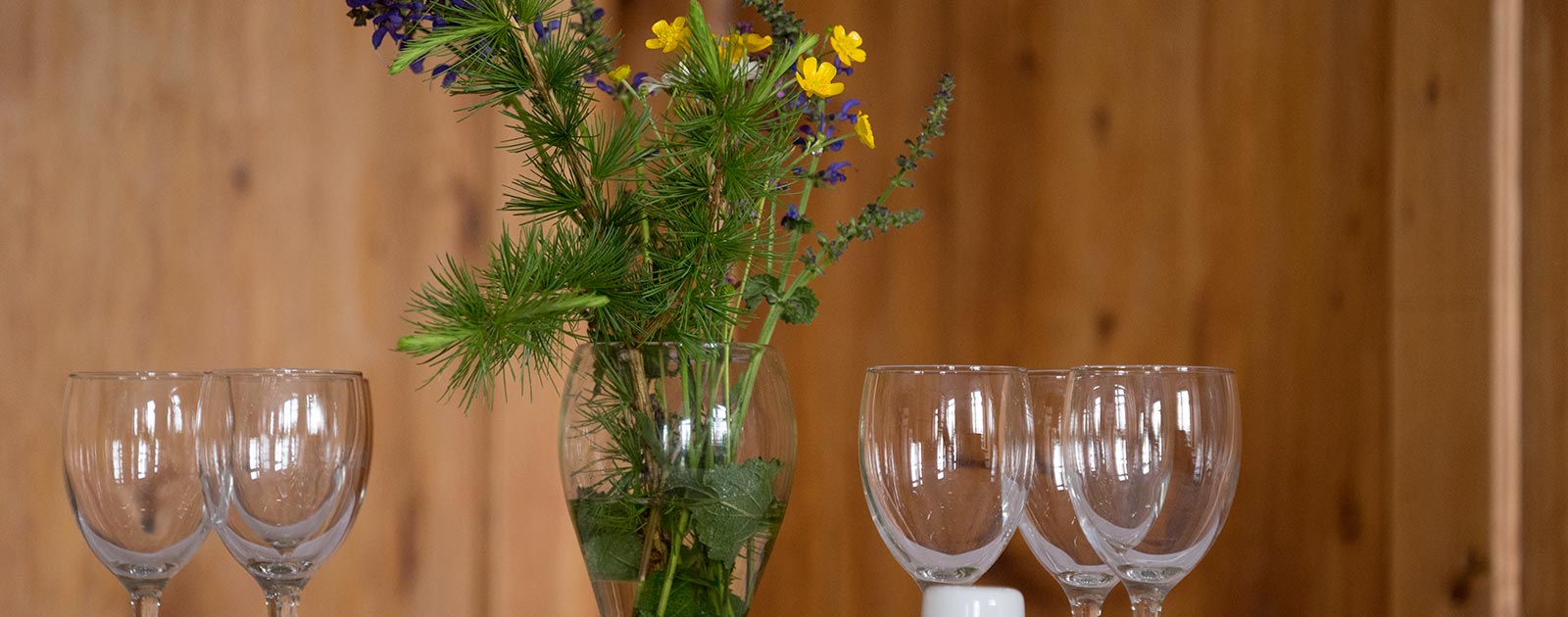 table decoration and wine glasses on a wooden table
