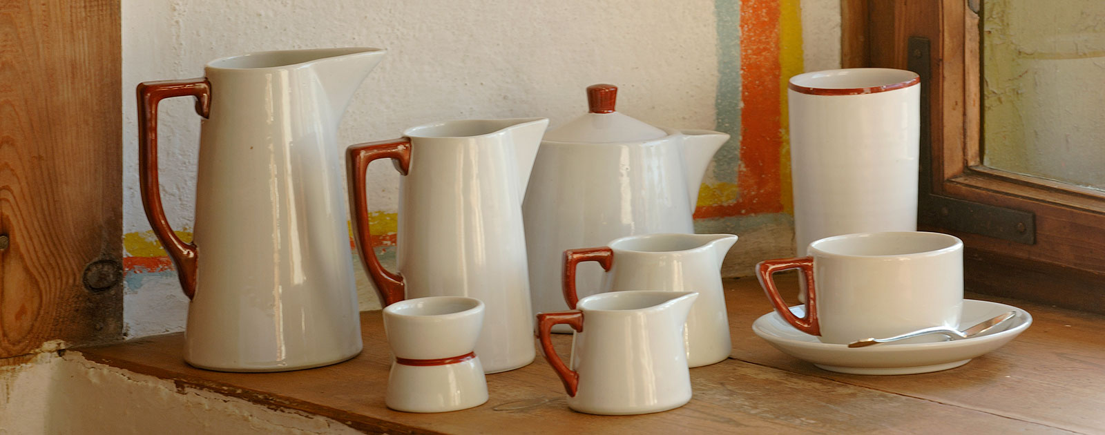 Set of antique teapots and milk jars with one cup